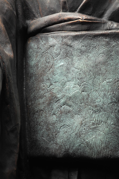 "Detail of obi on Bijin, a bronze sculpture of a kimono  53"" x 22"" x 26"""