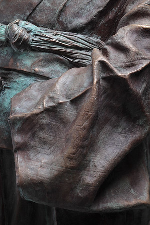 """Detail of a bronze sculpture, Young Maiko, of a kimono by Karen LaMonte which looks at perceptions of beauty culture and identity 38"""" x 20.5"""" x 17"""" 2010"""