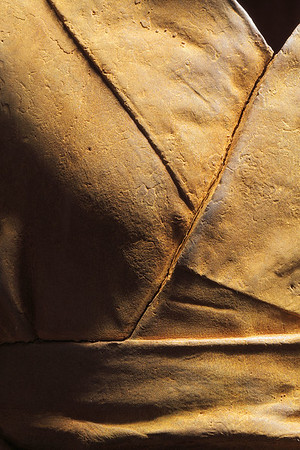 """Detail of rusted cast iron life-size sculpture of kimono called Hanako 48"""" x 20"""" x 17"""""""