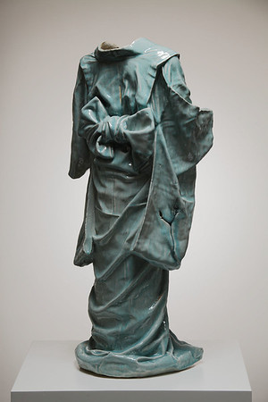 """This sculpture Child's Kimono asked questions about identity and culture 45"""" x 20"""" x 19"""" 2010, Ceramic with Celadon Glaze"""