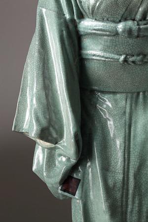 "Detail of life-size Kimono artwork in ceramic with celadon glaze called Ojigi - Bowing 49"" x 22"" x 17"" 2010"
