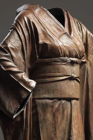 """Detail image of bronze sculpture of a kimono called Odoriko 54"""" x 30"""" x 17"""""""