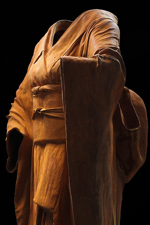 """Detail of life size rusted cast iron sculpture of kimono investigating perceptions of beauty 54"""" x 30"""" x 17"""""""
