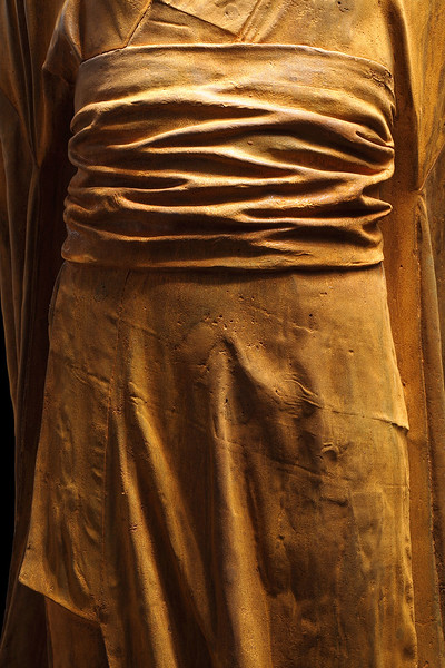 """Detail of rusted iron sculpture of a kimono by Karen LaMonte 48"""" x 20"""" x 17"""""""