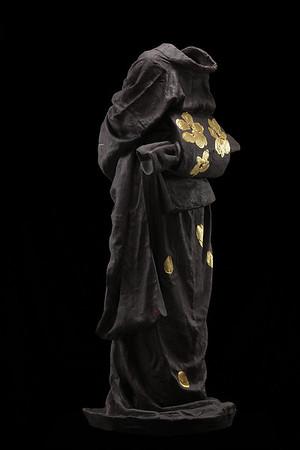 """Geisha is a ceramic sculpture of a kimono which investigates perception and culture 48"""" x 23"""" x 17"""" 2010"""