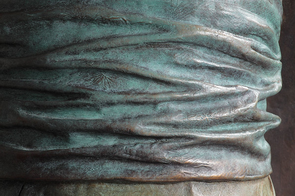 "Detail of bronze sculpture of kimono called Hanako 48"" x 20"" x 17"""
