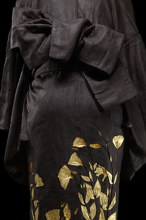 """Ojigi Bowing is a life size ceramic sculpture of a kimono by contemporary artist Karen LaMonte 47"""" x 22"""" x 17"""" 2010, Ceramic and Gold Leaf"""