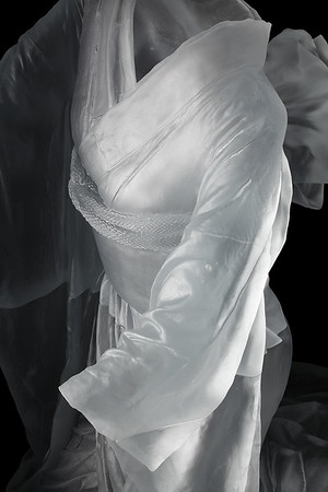 """Detail of life-size kneeling kimono sculpture with absent body called Chado  38"""" x 33"""" x 36"""" 2010, Cast Glass"""