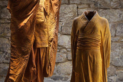 Art installation of sculptures of kimonos in rusted cast iron asking questions about self and society