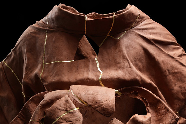 Detail of Kintsugi repaired ceramic kimono sculpture, an exploration of finding beauty in imperfection