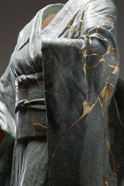 This contemporary sculpture of a ceramic kimono broke and was repaired with kintsugi  examining the beauty of impermanence