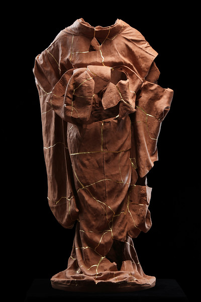 I repaired this broken sculpture of a kimono to explore the concept of time