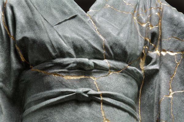 This contemporary artwork is a kintsugi repaired ceramic kimono examining the beauty of impermanence