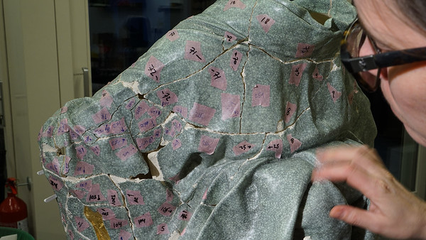 Repairing this broken ceramic kimono sculpture with kintsugi is like an archeological process
