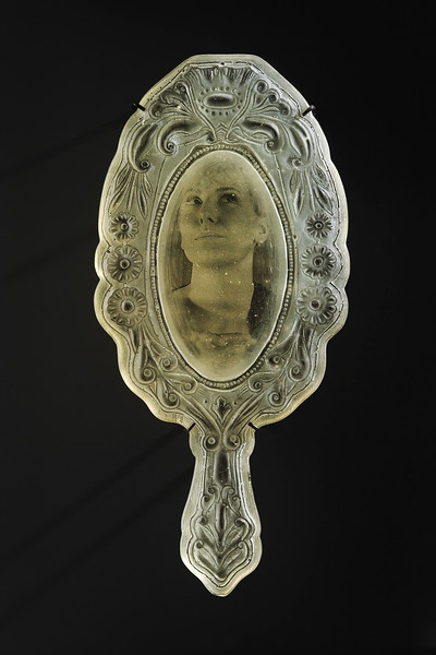 Sculpture of mirror with ghostly portrait capturing the emotion of a moment by Karen LaMonte