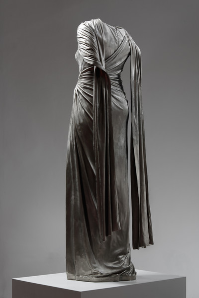 Artwork in white bronze of dress with flowing drapery