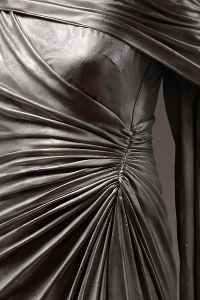 Closeup of drapery on life-size artwork of dress in white bronze