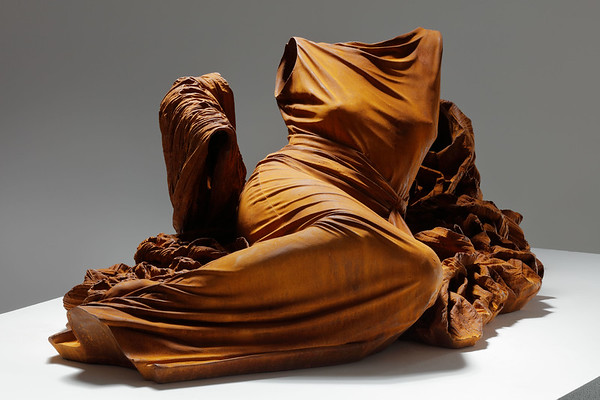 This sculpture of a dress without a body rendered in rusted iron is a feminist artwork examining culture and identity