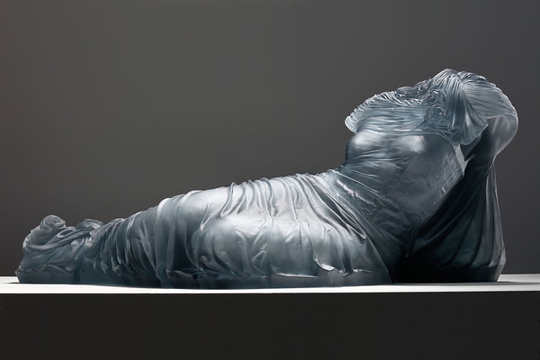 A Reclining Nocturne sculpture of a dress in glass by Karen LaMonte is a subversion of the traditional odalisque