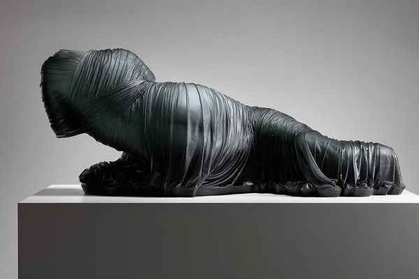 In this sculpture of a life-size dress in glass, an absent female nude is rising from darkened drapery in a feminist challenge to the male gaze.