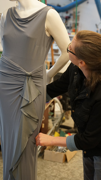 Artist Karen LaMonte working on dress for life-size sculpture of Nocturne in metal