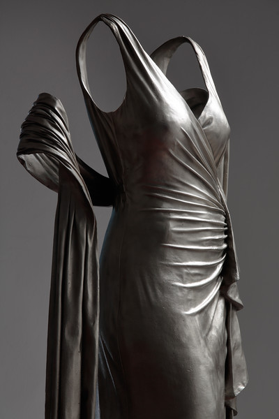 Closeup of sculpture of dress without a body investing ideas of being and not being