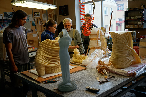 Karen LaMonte at foundry with Nocturne and Etude waxes for making sculptures using lost wax casting.