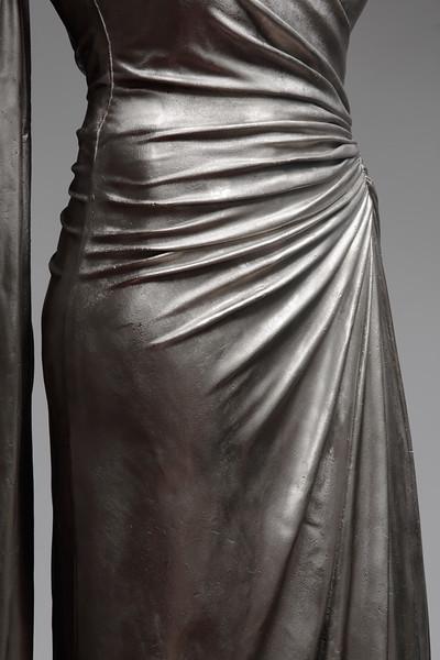 Detail of white bronze Nocturnes sculpture of dress