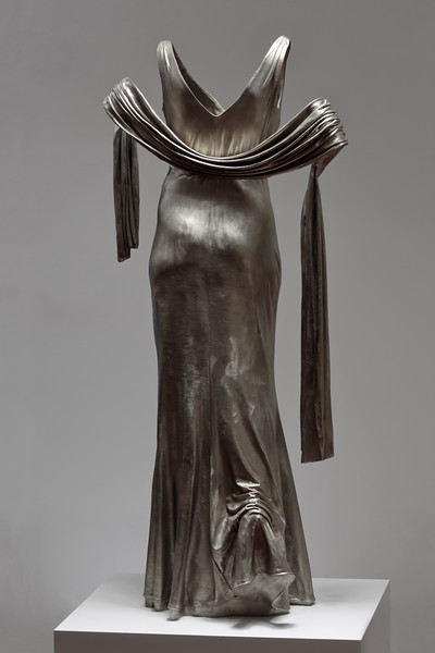 Artwork of dress in white bronze exploring transition and culture
