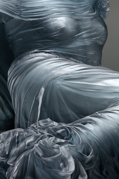 Traces of the body are visible through the folds and drapery of this sculpture of an absent reclining nude by Karen LaMonte