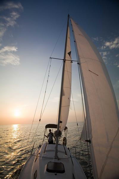 Sun set sail sea farer Chesapeake Bay night summer wind sailing Sara calm slow peaceful blue sky golden water evening sun down boat