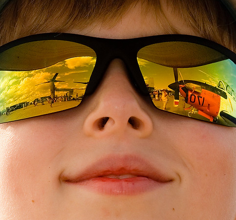 Air Show Visions:  Air show scenes fill the eyes of this young spectator.
