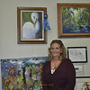 <b>Sheryl Hughes stands under her winning work of art, Elegance Of a Great Egret</b> November 3, 2013 <i>- Tony Lang</i>