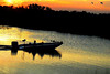 Description - Boating at Sunset on Perimeter Canal <b>Title - Boating at Loxahatchee</b> <i>- Leonard Friedman</i>
