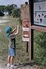 Description - Boy on Marsh Trail <b>Title - Born Photographer</b> 2nd Place <i>- William Burnett</i>