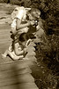 Description - Exploring Cypress Swamp from Boardwalk <b>Title - Cousins Exploring</b> <i>- Chris Binsbachar</i>