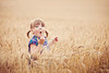 Alyssa Paro (3440-1) - Louisville, KY August 20, 2011 - My daughter Ava, in a field of wheat ©Veritas Photography (Toddler Entry)<br><br><br>Please help us choose the most adorable cuties to be our models at the Creative Edge Kids show in your area. This is a fun contest open to all photographers and is solely meant to find Americas cutest kids for a live model shoot with Sandy Puc. Simply review the images in the galleries below and leave a comment to vote in favor of the child. Remember you are voting on the child and not the photographers technique.