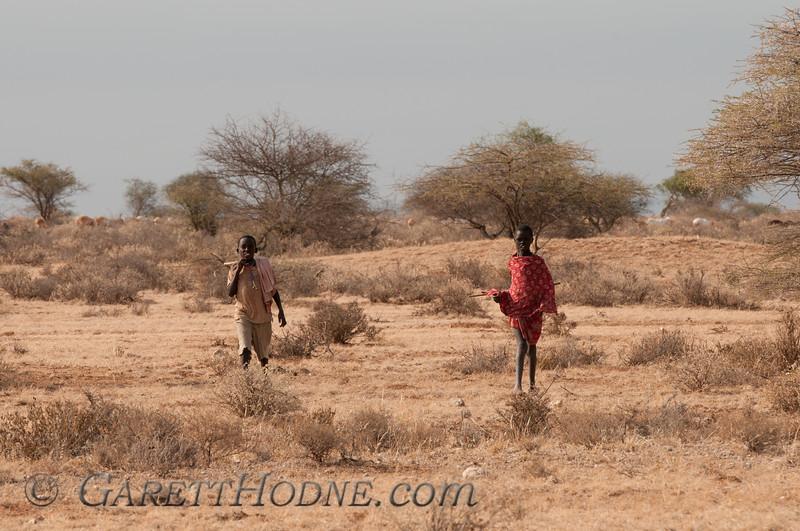 Two Masai boys coming to say hi.