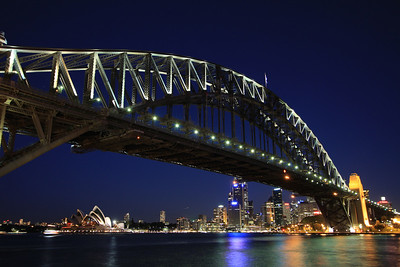 Sydney, Australia: The Harbour Bridge spans the Sydney Opera House.