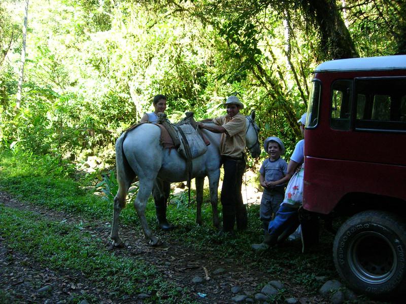 Costa Rican family picnic along a trail near