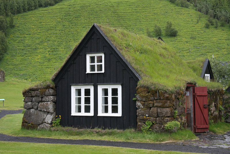 Turf-roofed houses near Skogar. South Iceland