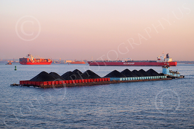 BARGE 00017 5 A barge loaded with coal pushed by a tugboat in New York Harbor, by John G Lomba