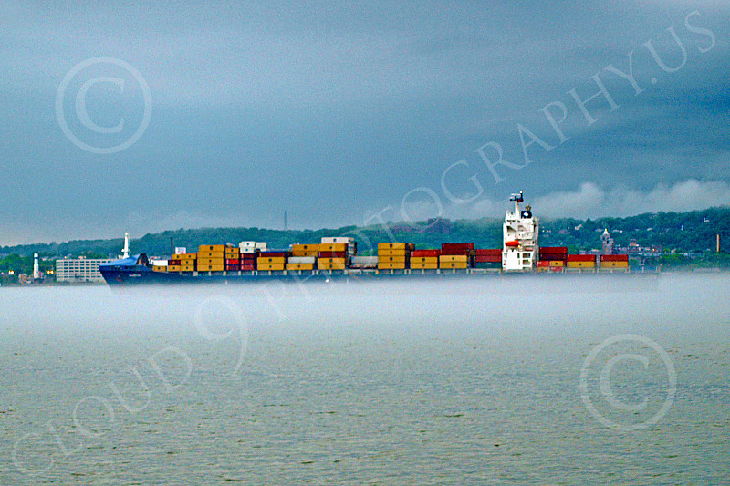 CCS 00017 A civilian cargo ship sails in the midsts of low hanging fog, by John G  Lomba