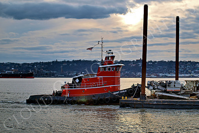 TUGB 00012 The tugboat HUNT GIRLS pushes a bare in New York Harbor, maritime picture, by John G Lomba