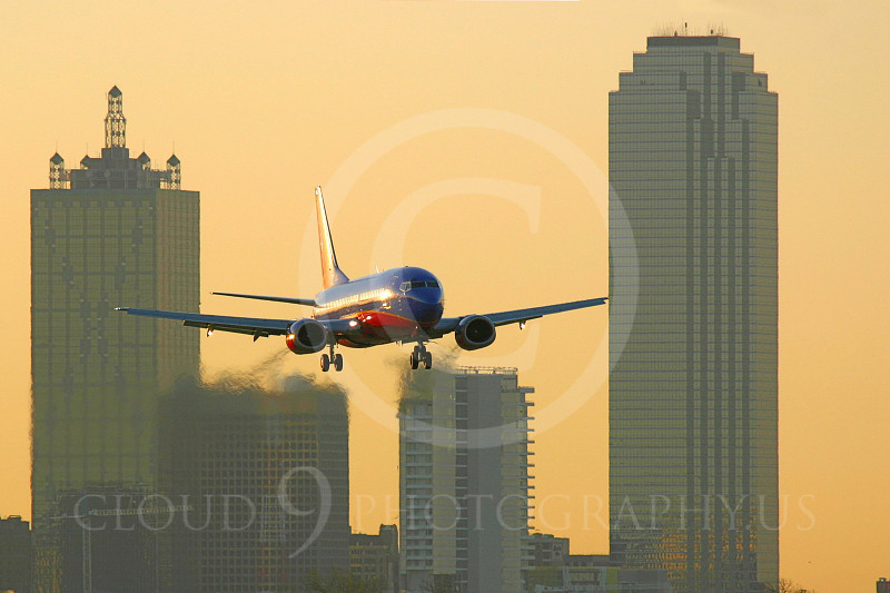 B737 00096 A Southwest Airlines Boeing 737 landing against a city skyline, by Tim Perkins