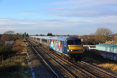82302 tnt 68015 on the 1Z12 Birmingham Moor Street to London Marylebone at Northolt park on the 16th December 2017