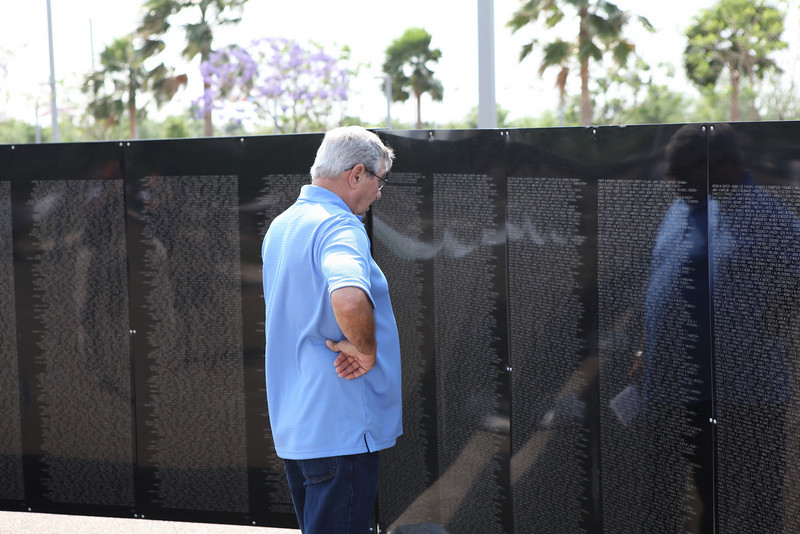 Man visits the Healing Wall on display at the McAllen Convention Center, for LZRGV, an event to honor Vietnam Veterans.  The free event will feature ceremonies, plays, workshops and entertainment all day Saturday, April 9, 2011.