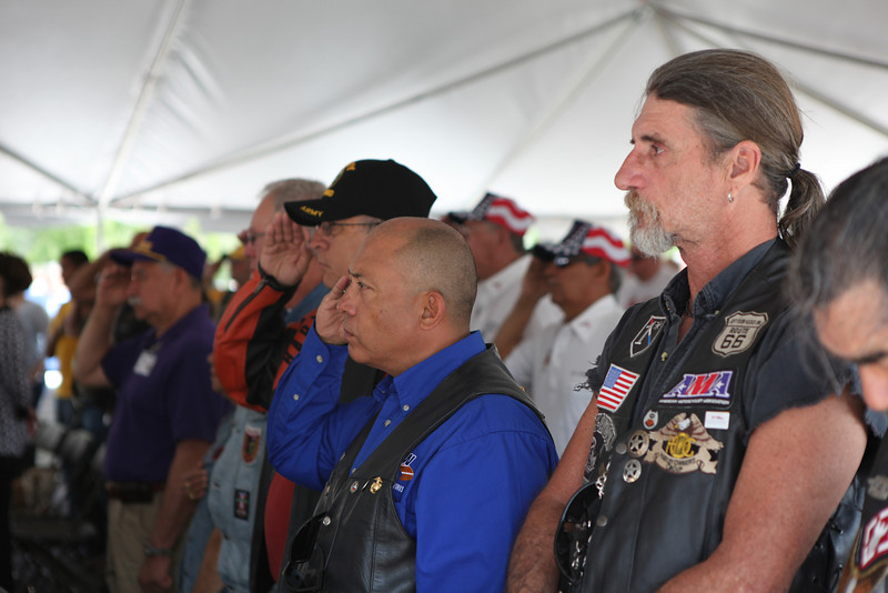 Veterans salute the flag at a news conference in McAllen for LZRGV, an event that features activities to honor Vietnam Veterans Saturday, at the McAllen Convention Center.