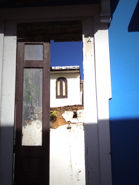 Many of the brightly-painted buildings were facades only; you could see through the open<br /> windows and door to the sky and buildings behind.