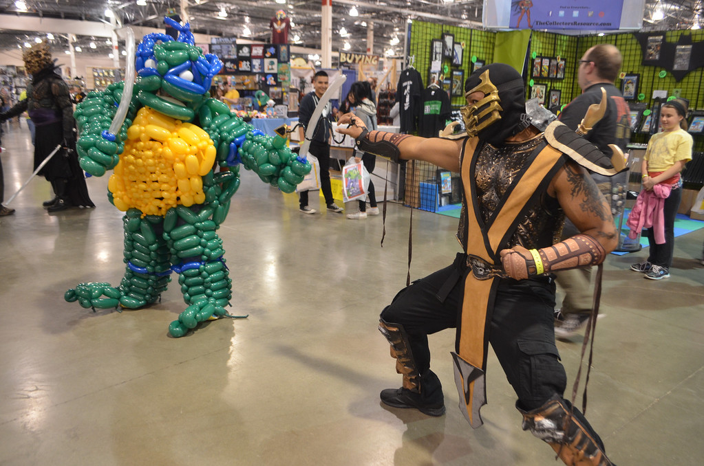 """. Cosplayers dressed as Leonardo the Ninja Turtle and Scorpion from the \""""Mortal Kombat\"""" video game franchise. Photo by Dave Herndon."""